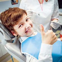 Little Boy Smiling in the Dental Clinic